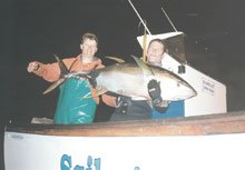 Local skipper of Sailor?s Joy, Deon van Antwerpen, is seen here on the left of Simone Karsten, holding the record Yellowfin Tuna