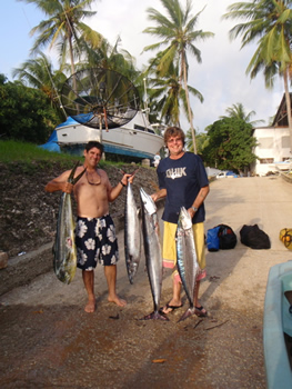 Eric Allard and Nigel Spenser with a good catch of Dorado, Wahoo and Cuda